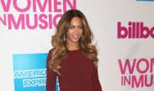 The Stylistic Beyonce is back with a leg-baring thigh-high slit Marsala Dress