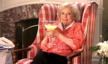 Betty White drinking from a huge glass of cocktail